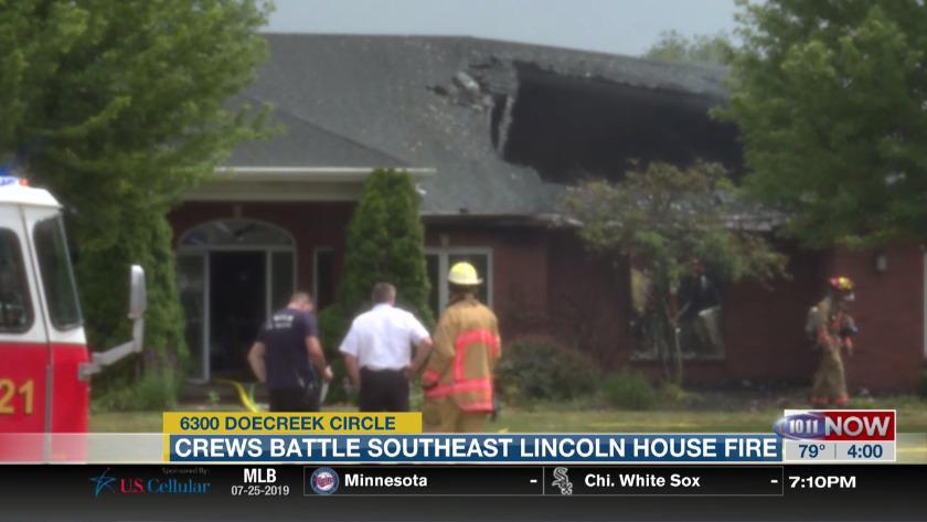Crews battle southeast Lincoln house fire