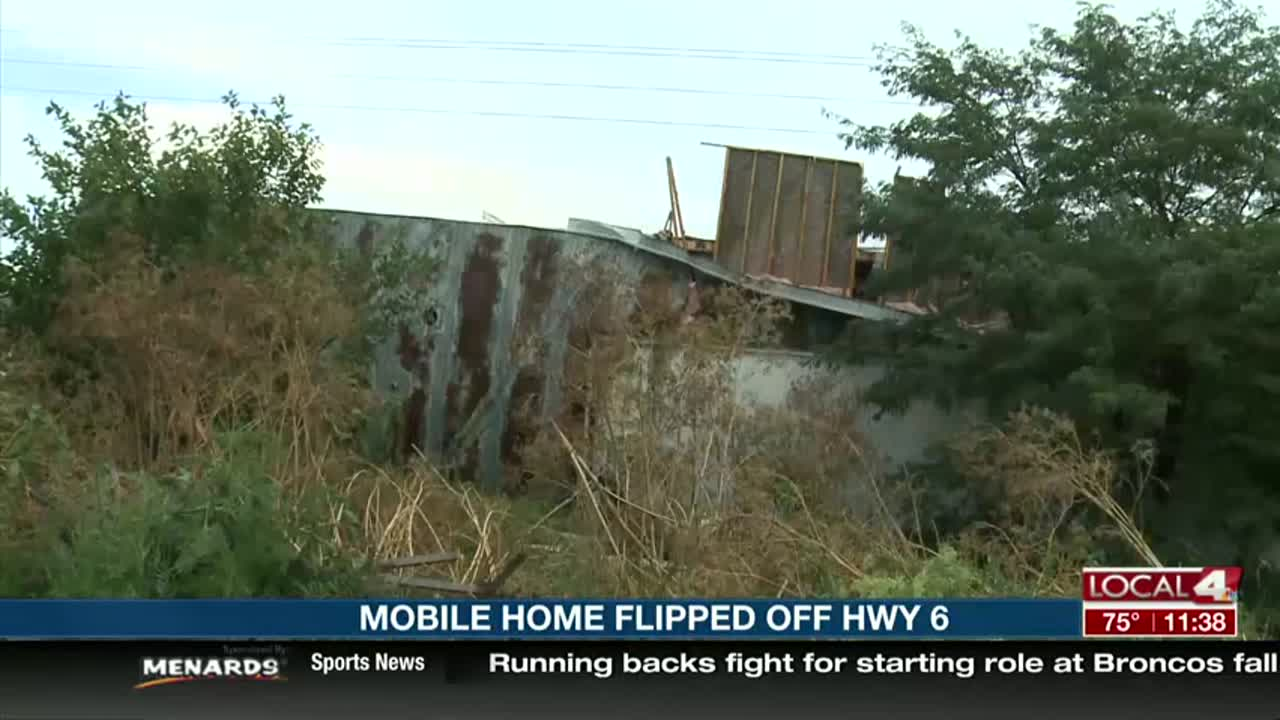 Storm flips mobile home trailer in Hastings on its side