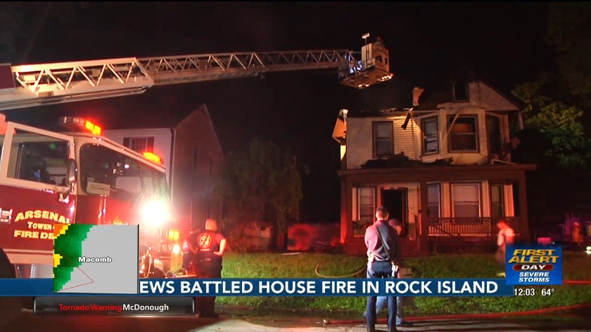 Rock Island firefighters battle house fire Thursday night