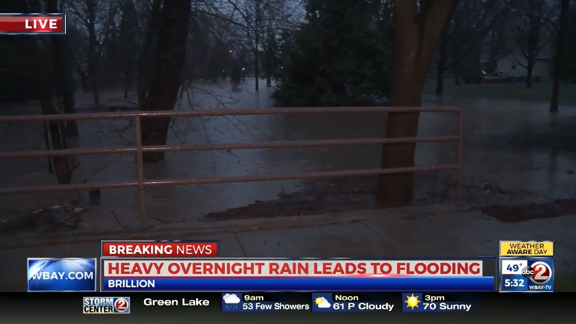 Heavy rain floods streets, basements