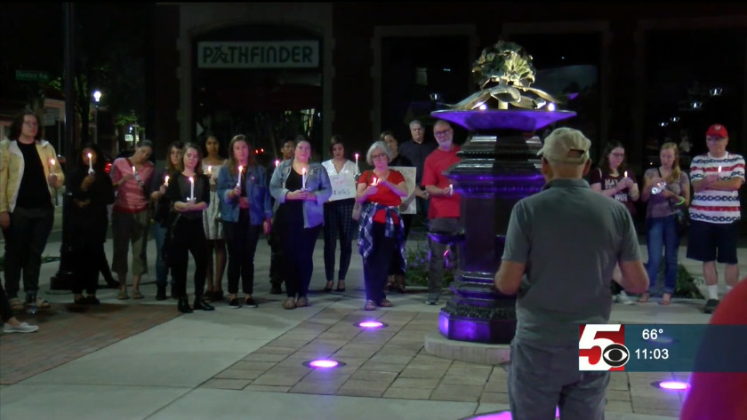 Protestors hold candlelight rally to show support for