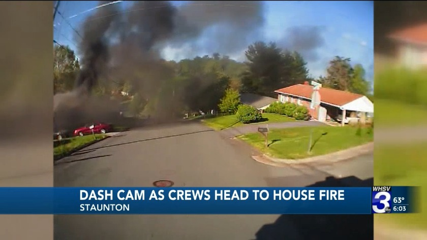 Dash cam captures moment fire engine arrive to fight house fire