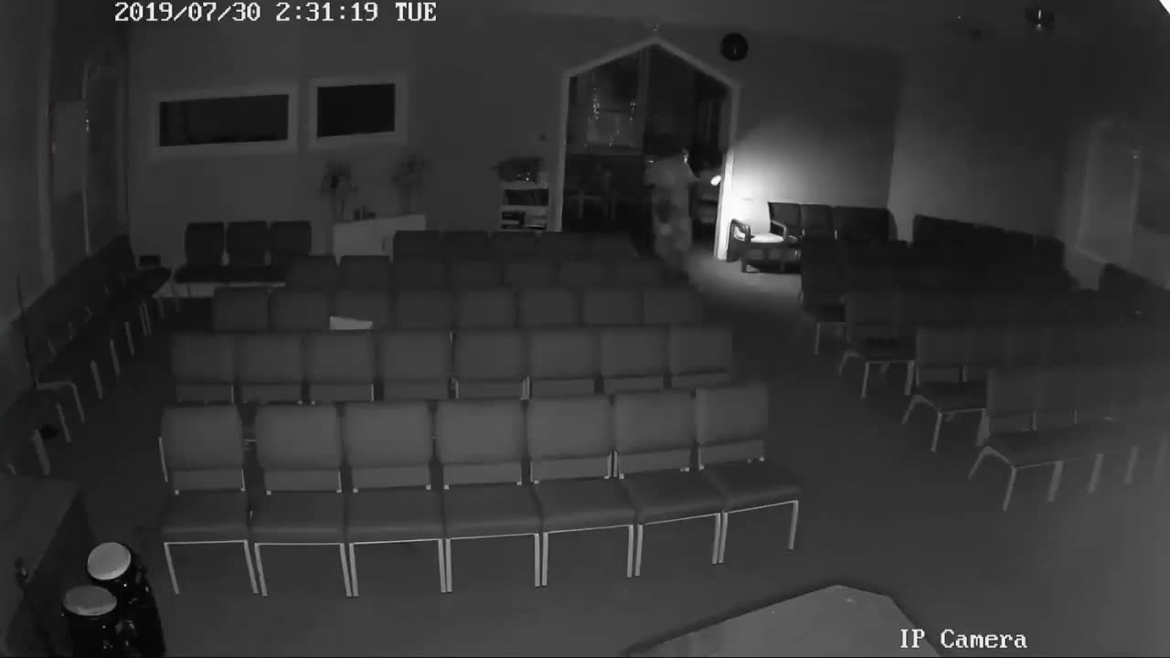 Security camera captures view of burglar stealing from church